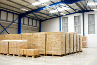pallets with cartons in warehouse